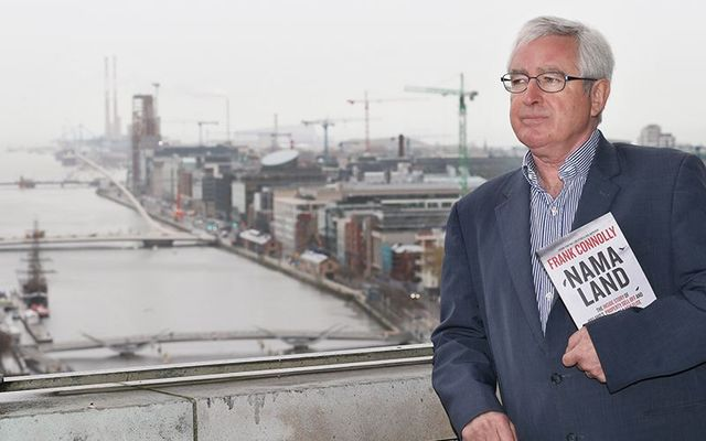 Author of NAMA Land, Frank Connolly, stands over looking construction sites in Dublin\'s docklands.