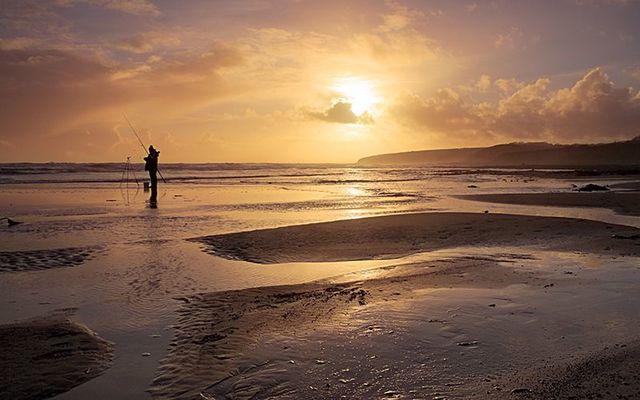 The sun rising over Ballybrannigan Beach in Co. Cork.