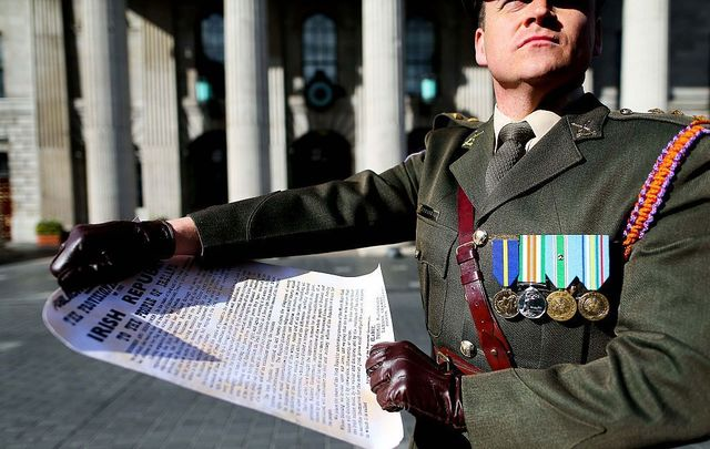 Captain Peter Kelleher from the 27th Infantry Battalion reads the Proclamation at the GPO on O\'Connell Street on March 27, 2016, in Dublin, Ireland.