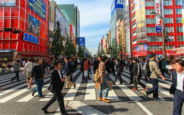 People crossing the street at Tokyo Akihabara area.
