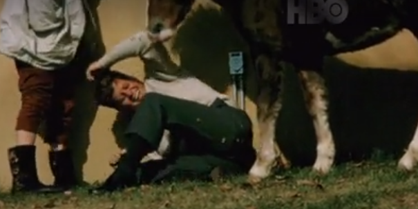 JFK plays with a horse the week before his death.