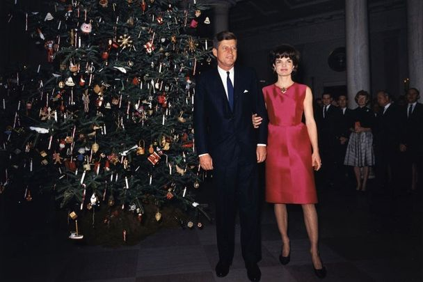 President Kennedy and wife Jackie at a White House staff Christmas Party December 1962.