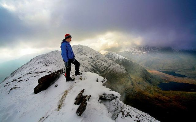 Taking in Ireland\'s winter beauty at the top of Carrauntoohil in Co. Kerry