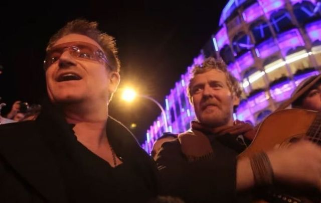 Bono and Glen Hansard busking on Christmas Eve 2012 in Dublin.