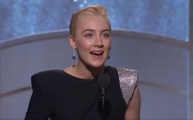 Saoirse Ronan accepts her Best Actress award at the 2018 Golden Globes Awards.
