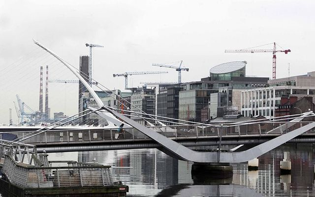 Cranes rise over Dublin\'s Silicon Docks.