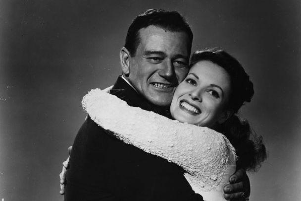 "Irish actress Maureen O\'Hara with John Wayne in a publicity still for \""The Quiet Man.\"""