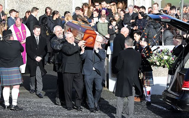The coffin of Dolores O\'Riordan carried out of her family church, in Ballybricken, County Limerick.