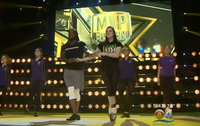 Alex Collins preparing alongside Irish dancers for his performance on CBS\'s \'Most Valuable Performer\' in 2018.