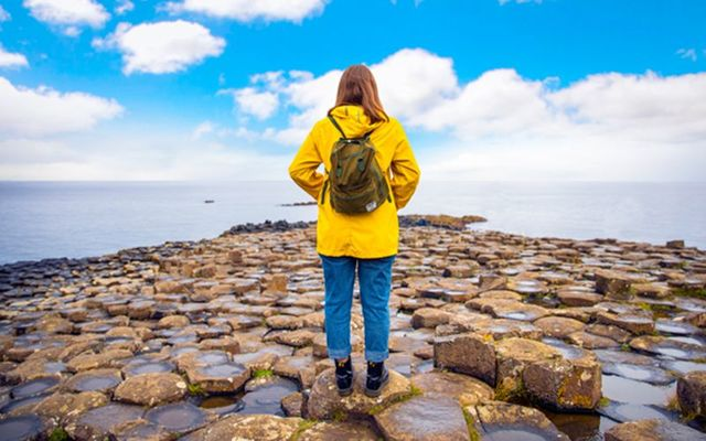 Standing at the Giant\'s Causeway, County Antrim, on an Irish Day Tour.