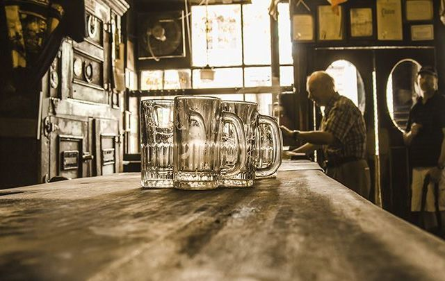 Empty pint glasses on a bar. Bar owners in Newmarket, Co Cork, will remain closed on Good Friday despite the lifting of the 90 year alcohol ban.