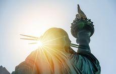 Thumb_mi_statue_of_liberty_immigrant_american_usa_sunset_istock__3_