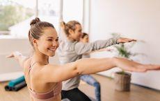 Thumb_woman_yoga_warrior_pose_yoga_istock