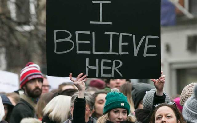 Woman holds up #IBelieveHer sign during a rally in Dublin on Thursday protesting the verdict of the Belfast rugby rape case.