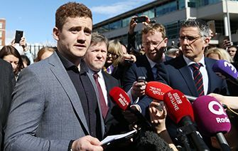 Found innocent: Paddy Jackson reading a statement outside court in Belfast.