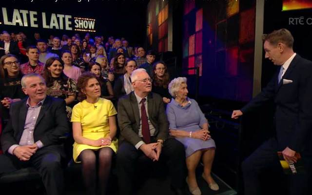 Late Late Show host Ryan Tubridy speaks to 90-year-old Irish mammy Nora Kelly as her 19 children look on.