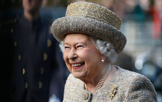 Queen Elizabeth II smiles as she arrives before the Opening of the Flanders\' Fields Memorial Garden at Wellington Barracks on November 6, 2014, in London, England.