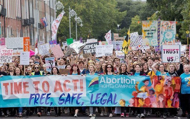 A large crowd holds up a signs to Repeal the 8th. Ireland will vote on the Irish referendum on May 25.