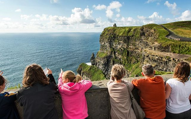 Tourists taking in the breath-taking views at the Cliffs of Moher, County Clare.