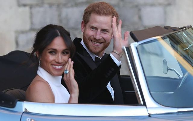 Meghan Markle and Prince Harry, the Duke and Duchess of Sussex, en route to the evening reception of their wedding.