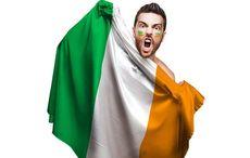 Thumb_cropped_man_hiding_behind_irish_flag_tircolour_istock