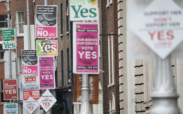 Yes and No Eighth Amendment abortion campaign posters along a street in Dublin.