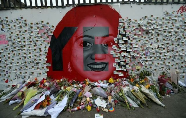 A mural of Savita Halappanavar with \'Together For Yes\' flyers in Dublin.