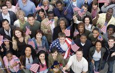 Thumb_mi_aerial_people_american_flags_usa_istock__1_