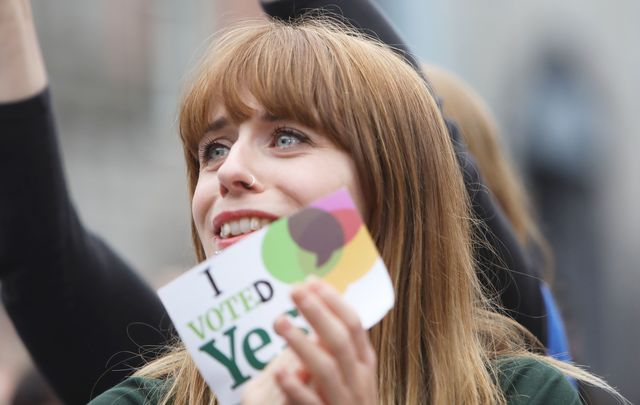 Women rejoice at a vote counting center on Saturday in Dublin.