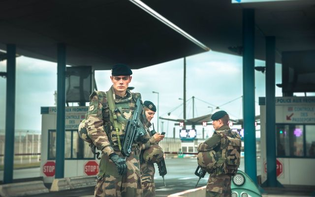 Military presence at France-UK border at Calais ferry terminal.