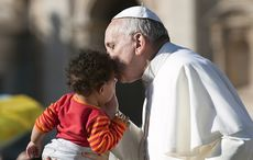 Thumb_pope_francis_kissing_baby_istock__3_