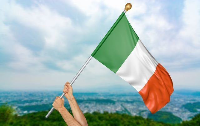 Someone proudly holding up the Irish flag.