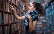 Thumb_woman-buying-book-istock