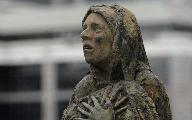 The horror of a Great Hunger victim\'s face - The Famine Memorial on Dublin\'s Liffey quays.