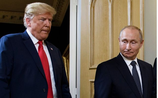 US President Donald Trump (L) and Russian President Vladimir Putin arrived for a meeting in Helsinki, on July 16, 2018.
