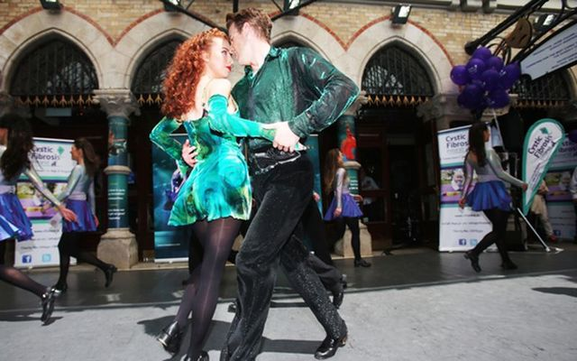 Lead dancers with Riverdance Amy-Mae Dolan James Greenan dance outside the Gaiety Theatre.
