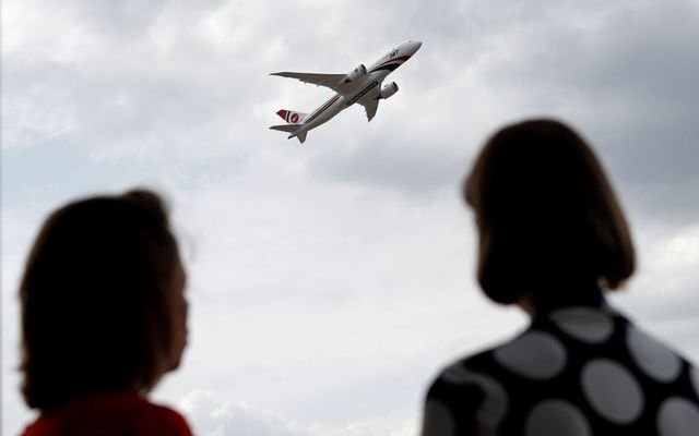 A Boeing 787-8 Dreamliner aircraft, operated by Biman Bangladesh Airlines, performs in a flying display at the Farnborough Airshow, south west of London, on July 18, 2018.