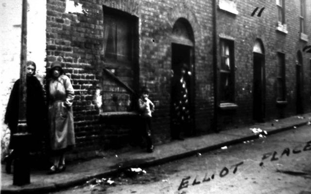 Women standing on the street corner of Elliot Place, in Monto, Dublin.
