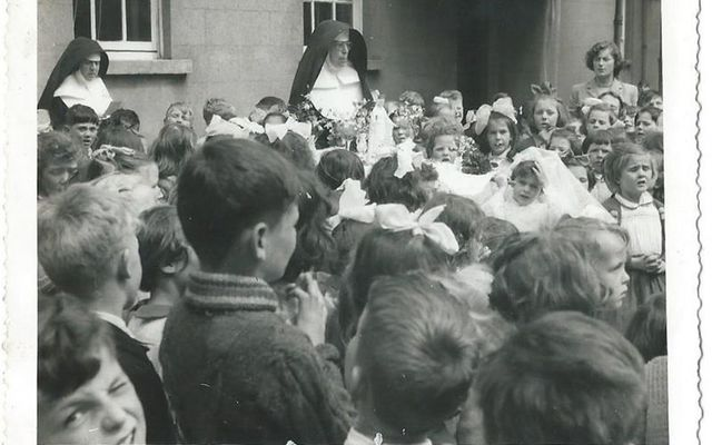 Catholic nuns oversee a school yard in Ireland in 1957.