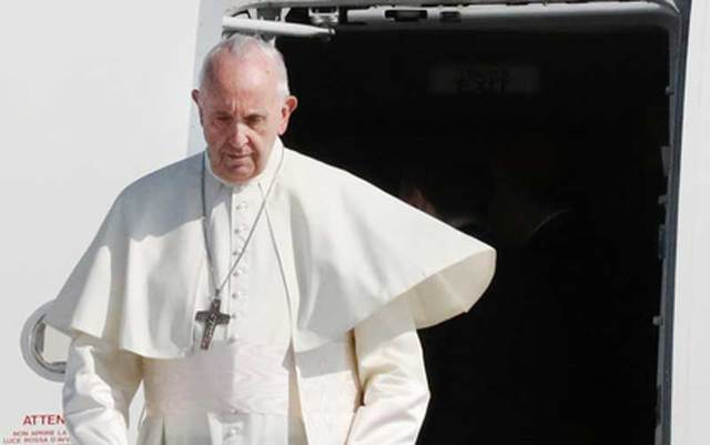 Pope Francis disembarks from his plane at Dublin Airport on the first day of his Ireland visit.