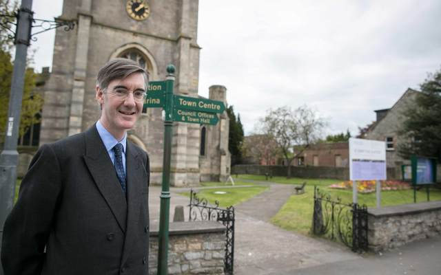 Conservative MP Jacob Rees-Mogg poses for a photograph near his constituency office in Keynsham on May 4, 2018, in North East Somerset, United Kingdom.