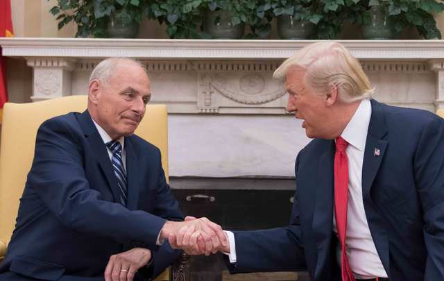 US President Donald Trump (R) shakes hands with newly sworn-in White House Chief of Staff John Kelly at the White House in Washington, DC, on July 31, 2017.