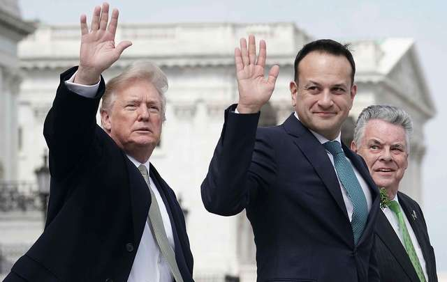 U.S. President Donald Trump (L) and Irish Taoiseach Leo Varadkar (2nd L) wave as U.S. Rep. Peter King (R-NY) (R) looks on after the Friends of Ireland luncheon March 15, 2018, on Capitol Hill in Washington, DC.