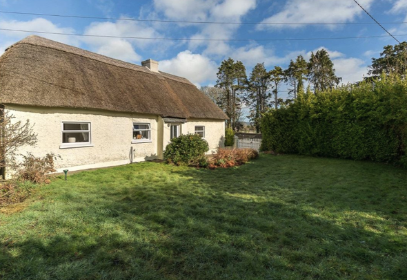 """The Thatched Cottage\"" in Co Kilkenny."