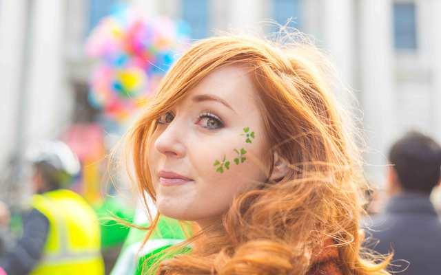Irish girl enjoying the parade, Dame Street, Dublin, Ireland.