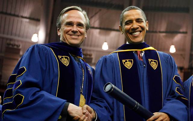 U.S. President Barack Obama shakes hands after receiving an honorary law degree from the University of Notre Dame by University President Rev. John I. Jenkins (L) during the 164th commencement ceremonies of the University of Notre Dame in the Joyce Center on May 17, 2009, in South Bend, Indiana.