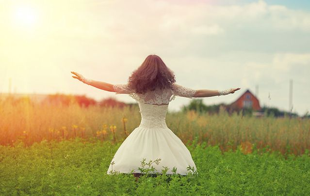 A woman with arms raised celebrating Lughnasa 2017/