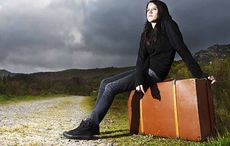 Thumb_mi_migratory_mourning_woman_suitcase_road_getty