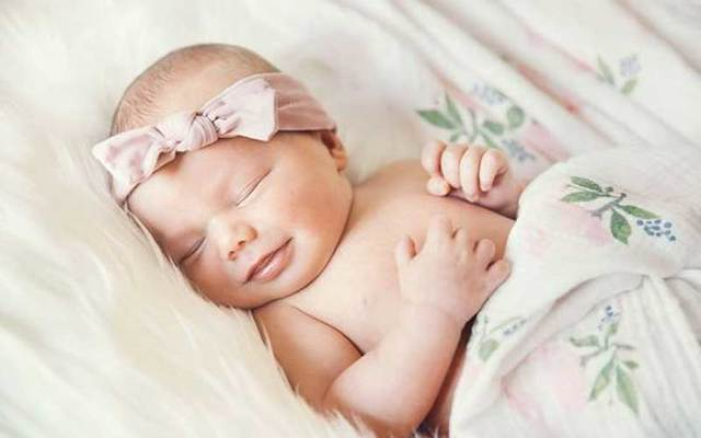 A newborn baby girl.