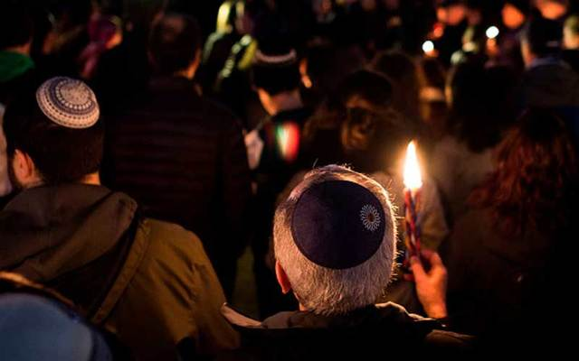 Members and supporters of the Jewish community come together in front of the White House for a candlelight vigil, in remembrance of those who died during a shooting at the Tree of Life Synagogue in Pittsburgh on October 27, 2018.
